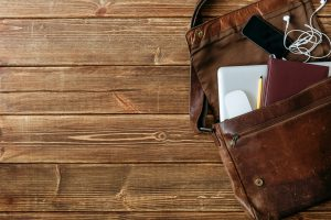 Leather bag with gadgets and notebooks